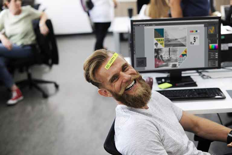Man smiling while in the office