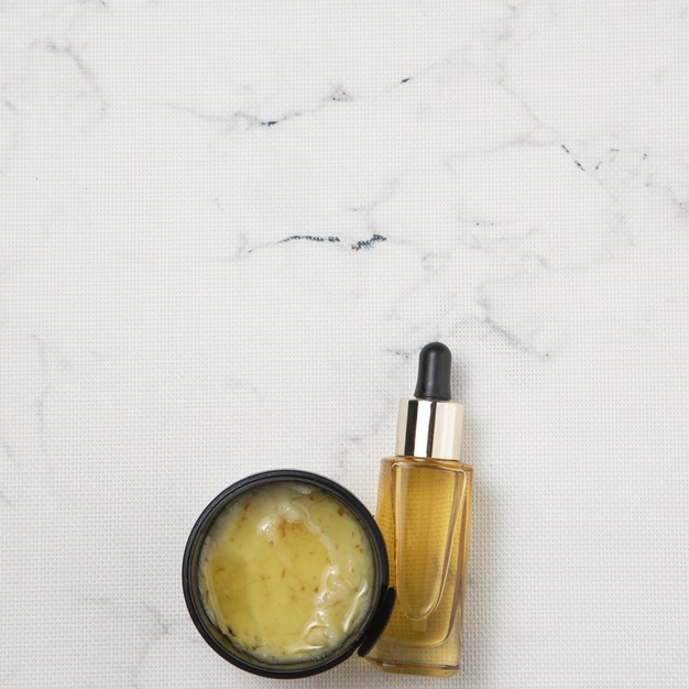 essential oil bottle in marble background